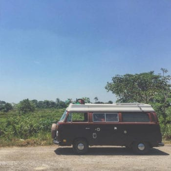 a Volkswagen Bus parked in a field